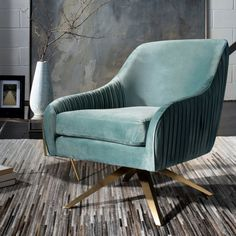 Savor the embrace of this luxurious contemporary pleated swivel armchair. Designers love its seafoam hue and the finely crafted pleats on its plush velvet upholstery. Its retro-style legs feature a radiant gold finish that highlights its chic mod style. Blue Dining Room Chairs, Shabby Chic Table And Chairs, Side Chairs, Office Chairs, Stylish Chairs, Modern Chairs, Swivel Armchair, Upholstered Chairs, Green Sofa Inspiration