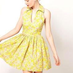 We love this cute little collar dress we found on FABSUGAR! So glad to see bright colors again!
