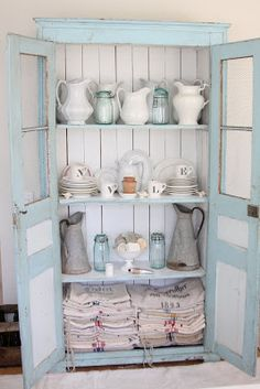 I love how she painted the inside of this cupboard in white and the outside in a pretty blue.