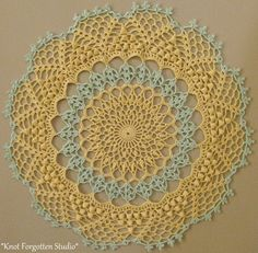 *Artistry*  This pattern is from Magic Crochet. Issue 93, December 1994.  I used Aunt Lydia's size 10 thread.  The colors are Maize and Mint Green.  Finished, December, 2014. https://www.pinterest.com/KnotForgottenSt/knot-forgotten-studio/