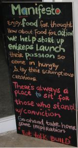 Briggy Hall's Manifesto  Enjoy food for thought? How about food for action?  We help startup entreps launch their passions.  So come in hungry and try their scrumptious creations.  There's always a place to sit for those who stand with conviction.  Go ahead take home some inspiration.  Eat. Talk. Build.
