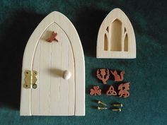 Fairy Door and window kit Kit includes, door and frame, 2 hinges and screws, door handle, matching window and a choice of 6 decorations. The window is made in 2 pieces, they aren't glued, this way it will be possible to paint the back piece separately. There is a hole in the back of the door and window so they can be hanged on a tree on a wall. It was created by scroll saw artist Joanne MacKenzie