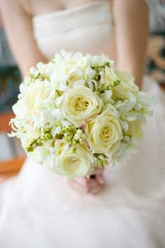 snowberries, white roses, white dendrobium orchid bouquet.  Classic and pretty! #becoflowers