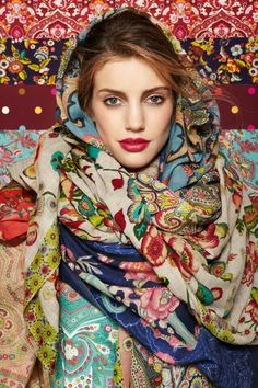 Traditional Russian babushka's head scarves - bright, floral, and kind of gypsy patterns. Their various embroideries, prints and fabrics served as an indicator of wearer's background and place of origin, as initially those scarves were produced at home and varied from village to village.