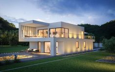 Massivhaus Kern-Haus Architektenhaus ArtA Garten Abend