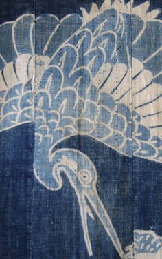 detail - a mid-to-late nineteenth century, indigo dyed cotton tsutsugaki yogi, a sleeping kimono onto which auspicious symbols have been hand drawn and resist-dyed