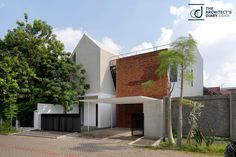 Home As An Oase - An Inneryard Focused To Be An Oasis And A Binder Uniting The Other Spaces - The Architects Diary New Staircase, Building Renovation, Brick Facade, Other Space, Stair Railing, Surabaya, Apartment Design, Contemporary Architecture, Exterior