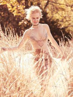 Posing outdoors, Nicole Kidman wears Dior dress | Photograph by Will Davidson | Vogue Australia | January 2017