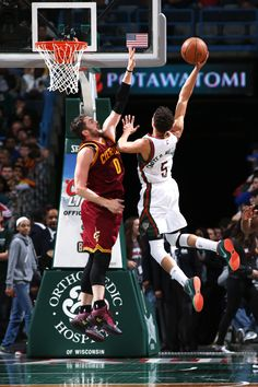 Michael Carter-Williams #5 of the Milwaukee Bucks goes up for a shot against the Cleveland Cavaliers on March 22, 2015 at BMO Harris Bradley Center in Milwaukee, Wisconsin. (Photo by Gary Dineen/NBAE via Getty Images)