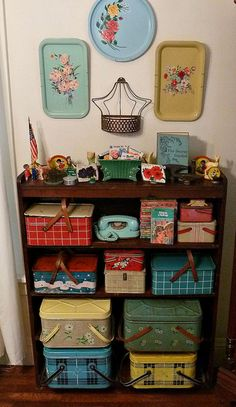 Pretty vintage trays would be just right in granny chic or cottage wall display. Granny chic decor, cottage decor and those vintage picnic tins are cute too.