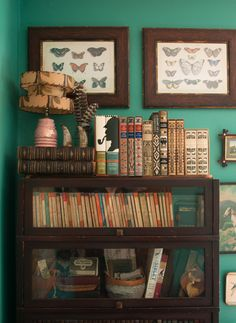barrister bookcase - The guest room's headboard, Hudson's Bay blanket, alpaca throw, alpaca pillow, and the vintage pillowcases are all yard sale finds. The vintage Penguin paperbacks inside the guest room bookcase are from an estate sale in New Jersey.