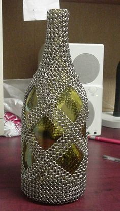 Wrapped Bottle - I could maybe use this to figure out how to make a flat-bottomed dicebag...
