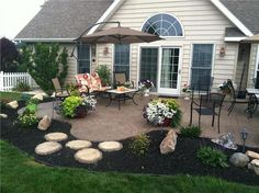 stamped concrete patio - love the shape and landscaping