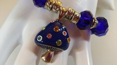 Handmade Bracelet Blue Swarovski Crystals Blue Glass Beads White Swarovski Crystals Pewter Beads Hearts Mushroom Charm MultiColor Rhinestone by IsabellaRobellini on Etsy