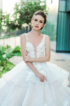 We first shared Filipino designer Mak Tumang's wedding gowns on Facebook and Instagram last April and, till today, we still frequently receive messages from brides all over the world asking us where they can find his creations. Mak Tumang studied interior design before delving into fashion in the Philippines. His love of opulent costumes and architecture influences his designs and this can be seen in his gowns which are rich in elaborate detail.