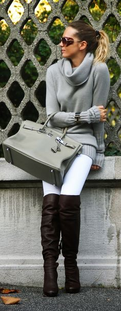 Perfect look. Slouchy grey sweater, white jeans and long boots.