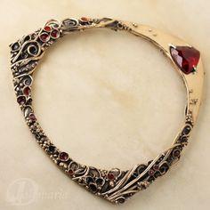 "Anna Mazoń / Drakonaria: ""Growth"" bracelet; bronze and resin with ruby"