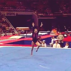 (gif of Shannon Miller's FHS+1.5-twisting front LO+BHS+LOSO)
