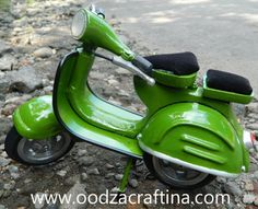 Green classic miniature scooter for your collection