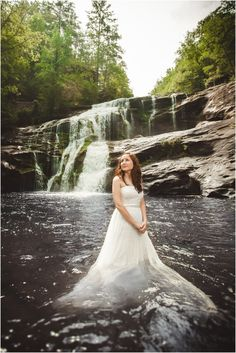 Bride in front of a waterfall. Click to view more pictures! Photo by JoPhoto. Knoxville wedding photographer, trash the dress