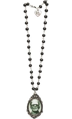 FRANKENSTEIN ROSARY NECKLACE    Good ole' Frank here is featured on a eerily delightful rosary necklace from Universal. This black beaded rosary necklace features an ornate, silver cameo with Frankenstein pictured in the center.    $24.00