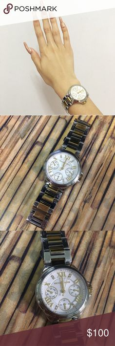 Gold Michael Kors Watch Beautiful authentic Michael Kors watch in silver and gold. Sold out everywhere and retails for $275. Has cute little diamonds inside the face of the watch. In great condition just needs new batteries. Stainless steel material Michael Kors Accessories Watches
