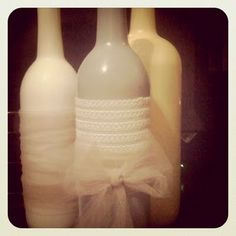 Wine bottle decor- spray paint and wrap in ribbon