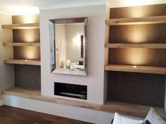 Cool shelves and love the lightening. But I'd have a tv where the mirror is
