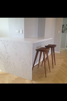 Euromarble Greek marble kitchen bench installed & finished on herringbone maple  parquetry