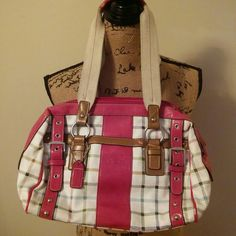 Coach heritage purse. Tartan pink Coach purse. Excellent condition inside and clean. Two outside compartment holders. Buckle front. Coach tag attached. Leather wear and tear noted in photos. Additional wear on pink leather. Zippers intact. Leather wear on strap. Carry strap wear. No dust bag. Coach Bags Hobos