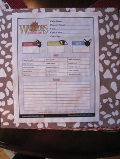 """Each girl took the """"what cat are you"""" test and the """"which clan are you"""" test on the Warriors website. They wrote their answers on the official Warriors Adventure Game Character Sheets. My daughter chose a local animal shelter to raise money using the Warrior Game points as dollars for a donation for all participants."""