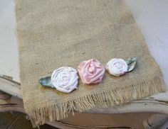 Add some shells or different colors to this shabby chic rose table runner