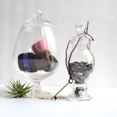 sewing supplies in apothecary jars