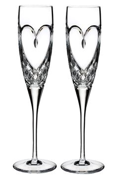 These gorgeous crystal flutes with a heart design will be adorable for the reception as well as holding onto them for future anniversaries.