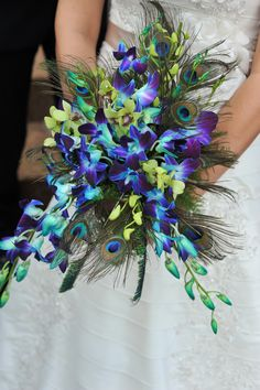 Wedding bouquet- bright blue Orchids floral mix with peacock feathers- Bridal Bouquet - hand-titled/cascading bouquet style