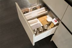Stash away all your items in one small cabinet or drawer. Efficiency starts with organization. Snaidero storage ideas are the perfect solutions to help you maximize functionality in the kitchen #SnaideroUSA