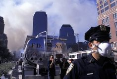 Rescue crews and police gather on the West Side Highway after the collapse of the World Trade Center's Twin Towers.Susan M
