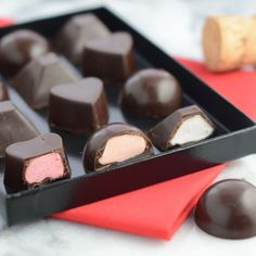 Fondant filled chocolates recipe. Create some of your chocolate box favourites at home - strawberry and orange creams and delicious after dinner mints.