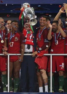 #EURO2016 Portugal manager Fernando Santos lifts the trophy following the UEFA Euro 2016 Final match between Portugal and France at Stade de France on July 10...