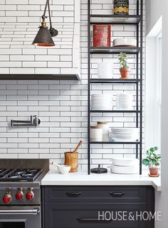 Lindsay Konior and Sarah Keenleyside of Qanuk Interiors Inc. discuss how they transformed a small, cluttered space into a bright eat-in kitchen with an open-plan layout and lots of storage. | Photo: Valerie Wilcox