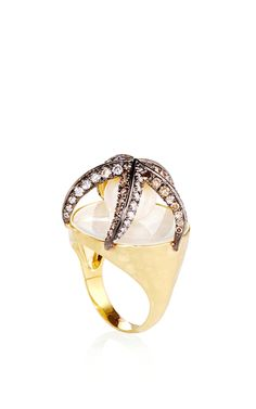 This playful 18K yellow gold ring by **Amsterdam Sauer x Bianca Brandolini** features a starfish construction embelished with diamonds, which holds a delicate pearl in its interior.