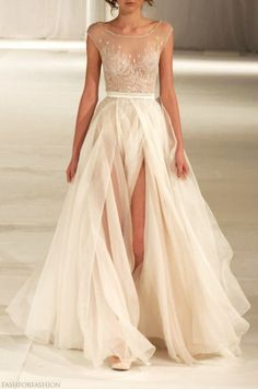 A tule skirt on your wedding dress. How romantic and beautiful is this dress. Prefect for the big day!