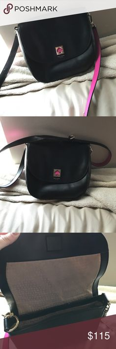 Kate Spade purse Lightly used. No stains on inner cloth. Slight scuff on back side lower corner. Great condition. Strap can be used to make it a hand bag rather than a crossbody. kate spade Bags Crossbody Bags