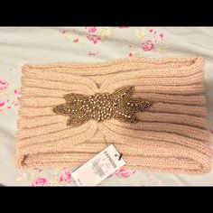 NWT Express Beaded warm winter headband. This beautiful beaded band is BNWT. Cream/Tan color with a beautiful design. Will keep your ears fashionably warm! Express Accessories Hats