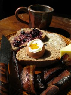 "Breakfast at Winterfell  ""There was much more than she'd asked for: hot bread, butter and honey and blackberry preserves, a rasher of bacon and a soft-boiled egg, a wedge of cheese, a pot of mint tea.  And with came Maester Luwin.""  -"