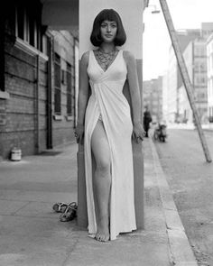 In the street in a white dress is listed (or ranked) 4 on the list The 20 Hottest Pictures Of A Young Helen Mirren