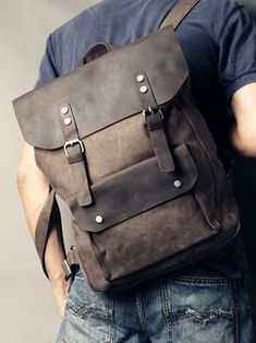 Copious: genuine leather and Canvas Rucksack Bag