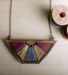 Inspired by the rising sun, this geometric wood necklace is finished with handstitched triangles in magenta, yellow and light blue. Before filling in with a sunburst of embroidery thread, the small holes are laser cut into the poplar wood, and the whole thing is suspended from an antiqued bronze chain. On those days your favorite white tee and jeans don't quite feel complete, this necklace is all you need to add a little something.