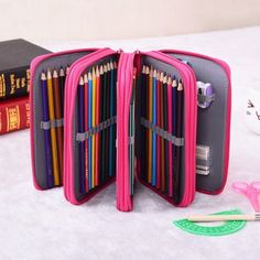 File away coloring and drawing pencils, (as many as 72!), in this zip-able pouch. | 24 Ridiculously Clever Ways To Organize Your Crafting Supplies