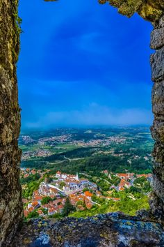 """wowtastic-nature:  The windows to Sintra by David Gomeson 500px○Canon EOS-1D X-f/16-1/100s-25mm-iso100, 2304✱3456px-rating:96.2☀""""This shot was taked from Castelo de Mouros, in Sintra, Portugal! The wether/sky was very closed! I waited over than one hour when the sky's window was opened. But is was greateful whit this beautiful view of Palacio Nacional de Sintra (Sintra National Palace).""""Photographer:David Gomes,Praia,Cabo Verde"""